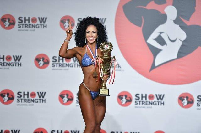 Overall Winner Women's Bikini Fitness - (#7) Sara May Garcia (Colombia) - at the Show of Strength 2018