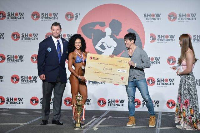 Overall Winner Women's Bikini Fitness receiving S$1,250 CASH PRIZE - (#7) Sara May Garcia (Colombia) - at the Show of Strength 2018